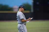 AZL Padres 1 manager Vinny Lopez (21) during an Arizona League game against the AZL Padres 2 at Peoria Sports Complex on July 14, 2018 in Peoria, Arizona. The AZL Padres 1 defeated the AZL Padres 2 4-0. (Zachary Lucy/Four Seam Images)