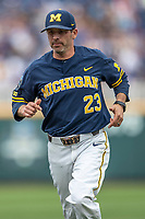 Michigan Wolverines assistant coach Nick Schnable (23) before Game 6 of the NCAA College World Series against the Florida State Seminoles on June 17, 2019 at TD Ameritrade Park in Omaha, Nebraska. Michigan defeated Florida State 2-0. (Andrew Woolley/Four Seam Images)