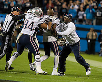 The Carolina Panthers play the New England Patriots at Bank of America Stadium in Charlotte North Carolina on Monday Night Football.  The Panthers defeated the Patriots 24-20.  New England Patriots cornerback Aqib Talib (31) is pulled away from Carolina Panthers wide receiver Steve Smith (89) by a Patriots coach