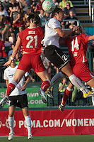 Abby Wambach of the magicJack wins the ball from Brittany Bock and Becky Edwards of the Western New York Flash. The Western New York Flash defeated the magicJack 3-0 in Women's Professional Soccer (WPS) at Sahlen's Stadium in Rochester, NY on May, 22 2011.