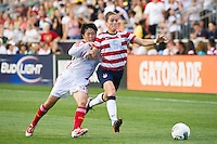 Kelley O?Hara (5) of the United States (USA) is marked by Weng Xin (16) of China PR (CHN). The United States (USA) women defeated China PR (CHN) 4-1 during an international friendly at PPL Park in Chester, PA, on May 27, 2012.