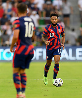 AUSTIN, TX - JULY 29: Eryk Williamson #19 of the United States brings the ball up the field during a game between Qatar and USMNT at Q2 Stadium on July 29, 2021 in Austin, Texas.