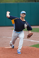 Myrtle Beach Pelicans pitcher Jake Stinnett (21) warming up in the bullpen before a game against the Charleston RiverDogs at Joseph P.Riley Jr. Ballpark on April 6, 2016 in Charleston, South Carolina. Myrtle Beach defeated Charleston  4-1. (Robert Gurganus/Four Seam Images)