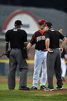 Batavia Muckdogs pitcher Ben Holmes (36) is examined by umpires Edwin Moscoso and Matt Carlyon for pine tar residue on his pants that was determined just a mud stain during a game against the Mahoning Valley Scrappers on August 22, 2014 at Dwyer Stadium in Batavia, New York.  Mahoning Valley defeated Batavia 2-1.  (Mike Janes/Four Seam Images)
