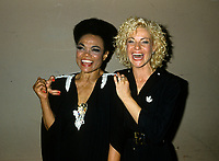 """Montreal (Qc) CANADA - August 8,1986 File Photo -<br /> <br /> Eartha Kitt (L) concert with Marjo (R) in Montreal.<br /> <br /> Eartha Mae Kitt (born on January 17, 1927)[1] is an American actress, singer, and cabaret star. She is known for her role as Catwoman in the 1960s TV series Batman, and for her 1953 Christmas song """"Santa Baby."""" Orson Welles once called her """"the most exciting woman in the world."""".<br /> <br /> Marjol??ne Morin (born 2 August 1953 in Montreal, Quebec), professionally known as Marjo, is a francophone Canadian singer-songwriter. After singing in two musicals of Fran??ois Guy, Marjo joined the band Corbeau in 1979, two years after the group was started by Pierre Harel.<br /> <br /> Her solo career began shortly after Corbeau disbanded with the theme song for the film La Femme de l'h??tel which earned a Genie Award for Best Original Song in 1985. In 1986, her debut album Celle qui va sold more than 250 000 copies.<br /> <br /> -Photo (c)  Images Distribution"""