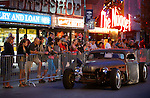 Thousands of people watch as classic cars cruise in downtown Reno, Nev., on Wednesday night, Aug. 7, 2013, during the official Kick-Off Cruise of Hot August Nights. (AP Photo/Cathleen Allison)