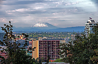 Mount St. Helens glows in the background one summer evening in Portland, Oregon.