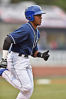Asheville Tourists right fielder Randy Reyes (22) runs to first during game one of a double header against the Greenville Drive on April 18, 2015 in Asheville, North Carolina. The Tourists defeated the Drive 2-1. (Tony Farlow/Four Seam Images)
