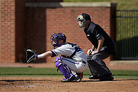 High Point Panthers catcher Spencer Brown (26) sets a target as home plate umpire David Pritchett looks on during the game against the NJIT Highlanders at Williard Stadium on February 19, 2017 in High Point, North Carolina. The Panthers defeated the Highlanders 6-5. (Brian Westerholt/Four Seam Images)
