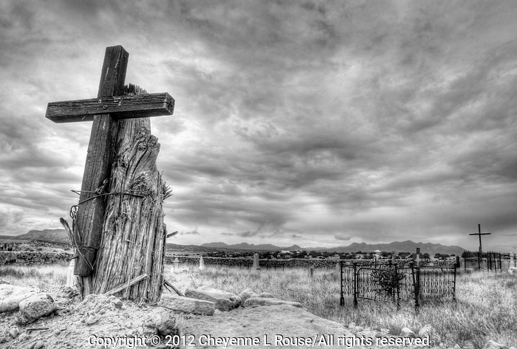 Mystical New Mexico - Rustic cross on cemetery wall in Northern New Mexico