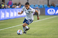 SAN JOSE, CA - MAY 01: Andy Najar #14 of DC United dribbles the ball during a game between San Jose Earthquakes and D.C. United at PayPal Park on May 01, 2021 in San Jose, California.