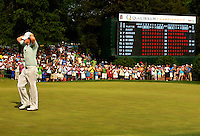 Rory McIlroy of Northern Ireland celebrates as he holes a birdie putt on the 18th green to secure victory during the final round of the Quail Hollow Championship at Quail Hollow Country Club on May 2, 2010 in Charlotte, North Carolina.  The event, formerly called the Wachovia Championship, is a top event on the PGA Tour, attracting such popular golf icons as Tiger Woods, Vijay Singh and Bubba Watson. Photo from the final round in the Quail Hollow Championship golf tournament at the Quail Hollow Club in Charlotte, N.C., Sunday , May 03, 2009..
