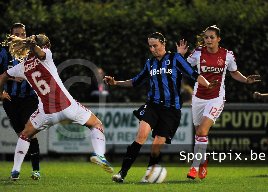 20130830 - VARSENARE , BELGIUM : Brugge's Heleen Jaques pictured trying to avoid tackle from Ajax' Anouk Hoogendijk (6) during the female soccer match between Club Brugge Vrouwen and Ajax Amsterdam Dames , of the first matchday in the BENELEAGUE competition. Friday 30 August 2013. PHOTO DAVID CATRY