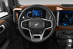 Car pictures of steering wheel view of a 2021 Ford Bronco Outer-Banks 5 Door SUV Steering Wheel