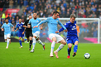 Aymeric Laporte of Manchester City vies for possession with Danny Ward of Cardiff City during the Premier League match between Cardiff City and Manchester City at Cardiff City Stadium on  in Cardiff, Wales, UK. Saturday 22 September 2018