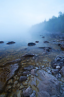 Fog Rolling at dusk over the rocky shoreline of Little Cove, Georgian Bay, Ontario
