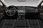 Stock photo of straight dashboard view of 2016 Jaguar XJ Premium Luxury 4 Door Sedan Dashboard