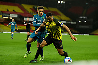 26th December 2020; Vicarage Road, Watford, Hertfordshire, England; English Football League Championship Football, Watford versus Norwich City; Troy Deeney of Watford competes for the ball with Max Aaron of Norwich City