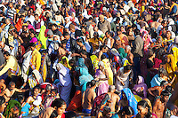 India. Uttar Pradesh state. Allahabad. Maha Kumbh Mela. A crowd of Indian Hindu devotees at sunrise in Sangam where people take holy dips. The Kumbh Mela, believed to be the largest religious gathering is held every 12 years on the banks of the 'Sangam'- the confluence of the holy rivers Ganga, Yamuna and the mythical Saraswati. In 2013, it is estimated that nearly 80 million devotees took a bath in the water of the holy river Ganges. The belief is that bathing and taking a holy dip will wash and free one from all the past sins, get salvation and paves the way for Moksha (meaning liberation from the cycle of Life, Death and Rebirth). Bathing in the holy waters of Ganga is believed to be most auspicious at the time of Kumbh Mela, because the water is charged with positive healing effects and enhanced with electromagnetic radiations of the Sun, Moon and Jupiter. The Maha (great) Kumbh Mela, which comes after 12 Purna Kumbh Mela, or 144 years, is always held at Allahabad. Uttar Pradesh (abbreviated U.P.) is a state located in northern India. 9.02.13 © 2013 Didier Ruef