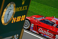 "The #99 Gainsco/Bob Stallings Racing Chevrolet Corvette of Jon Fogarty, Alex Gurney passes by the Rolex 24 ""Countdown Clock"" along pit road during practice."