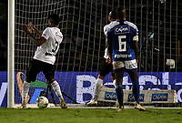 BOGOTA - COLOMBIA, 27-11-2020: Jose Junior Bueno de Once Caldas, anota gol a Juan Moreno (Fuera de Cuadro) de Millonarios F. C., durante partido entre Millonarios F. C. y Once Caldas de la fecha 1 por la Liguilla BetPlay DIMAYOR 2020 jugado en el estadio Nemesio Camacho El Campin de la ciudad de Bogota. / Jose Junior Bueno of Once Caldas, scored a goal to Juan Moreno (Out of Pic) of Millonarios F. C., during a match between Millonarios F. C. and Once Caldas of the 1st date for the BetPlay DIMAYOR 2020 Liguilla played at the Nemesio Camacho El Campin Stadium in Bogota city. / Photo: VizzorImage / Luis Ramirez / Staff.