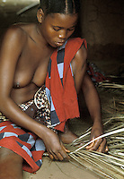 Young woman of Kpelle tribe weavinga mat, Liberia, West Africa