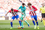 Saul Iniguez and Antoine Griezmann of Atletico de Madrid competes for the ball with Leo Messi of Futbol Club Barcelona  during the match of Spanish La Liga between Atletico de Madrid and Futbol Club Barcelona at Vicente Calderon Stadium in Madrid, Spain. February 26, 2017. (ALTERPHOTOS)