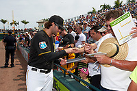 Pittsburgh Pirates pitcher Trevor Williams (64) signs autographs before a Spring Training game against the Toronto Blue Jays  on March 3, 2016 at McKechnie Field in Bradenton, Florida.  Toronto defeated Pittsburgh 10-8.  (Mike Janes/Four Seam Images)
