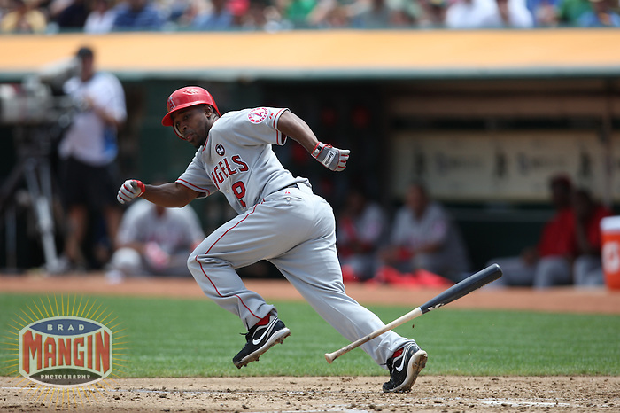 OAKLAND, CA - JULY 18:  Chone Figgins #9 of the Los Angeles Angels of Anaheim bunts against the Oakland Athletics during the game at the Oakland-Alameda County Coliseum on July 18, 2009 in Oakland, California. Photo by Brad Mangin