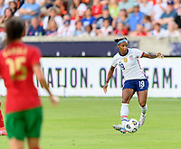 HOUSTON, TX - JUNE 10: Crystal Dunn #19 of the United States looks to pass the ball during a game between Portugal and USWNT at BBVA Stadium on June 10, 2021 in Houston, Texas.