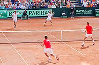 15-09-12, Netherlands, Amsterdam, Tennis, Daviscup Netherlands-Suisse, Doubles, Robin Haase/Jean-Julian Rojer vs   Roger Federer/Stanislas Wawrinka.(foreground)