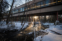 Steam rises off Chester Creek as the sun rises behind the UAA Spine on a cold February morning.