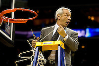North Carolina head coach Roy Williams cuts down the net during the NCAA Basketball Men's East Regional at Time Warner Cable Arena in Charlotte, NC.