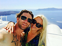 Pictured: (L-R) Greg Symonds with wife Tamsin<br /> Re: Police searching to find the driver who left an SAS soldier for dead on a darkened road has been suspended in the United States.<br /> Greg Symonds from Newport, Wales, died of a skull fracture following the 'hit and run' last year.<br /> An inquest held in Hereford today heard the 31-year-old had been in California on exercise with the Parachute Regiment before he was run over.<br /> Car debris found at the scene and CCTV images showing a matching silver Toyota Camry prior to the crash, have not yet been matched to a car.