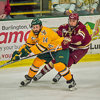 19 February 2016: University of Vermont Catamount Forward Kevin Irwin, a Sophomore from Akron, Ohio, works against Boston College Eagle Defenseman Steve Santini, a Junior from Mahopac, NY, in the third period at Gutterson Fieldhouse in Burlington, Vermont. The Eagles defeated the Catamounts 3-1 in the first game of their weekend series. Mandatory Credit: Ed Wolfstein Photo *** RAW (NEF) Image File Available ***