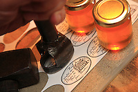 Manual cutting of the labels for the most expensive honey in the world, that of the Paris Opera house. And, paradoxically, one of the most traditional.