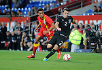 14th August 2013 - Cardiff - UK : Wales v Republic of Ireland - Vauxhall International Friendly at Cardiff City Stadium : Seamus Coleman of Ireland is chased by Neil Taylor of Wales.