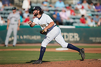 Charleston RiverDogs relief pitcher Andrew Gross (33) follows through on his delivery against the Augusta GreenJackets at Joseph P. Riley, Jr. Park on June 27, 2021 in Charleston, South Carolina. (Brian Westerholt/Four Seam Images)