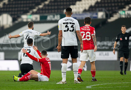 7th November 2020; Pride Park, Derby, East Midlands; English Football League Championship Football, Derby County versus Barnsley; Nathan Byrne of Derby County and Conor Chaplin of Barnsley look to Referee Leigh Doughty for a decision after a foul