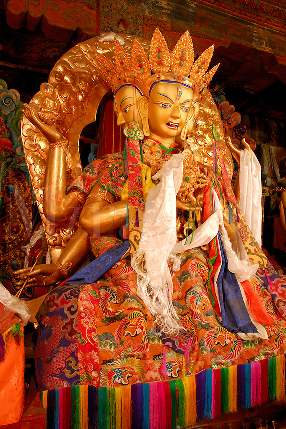 Namgyelma, with three-faces, eight-arms, and ten eyes, holding the nectar of immortality, a peaceful female deity of long life, draped with white silk prayer scarves on a lotus seat at Sera Monastery, Lhasa, Tibet, China.
