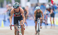 14 SEP 2013 - LONDON, GBR - Vicky Holland (GBR) (left) of Great Britain exits transition for the start of the bike during the elite women's ITU 2013 World Triathlon Series Grand Final in Hyde Park, London, Great Britain (PHOTO COPYRIGHT © 2013 NIGEL FARROW, ALL RIGHTS RESERVED)