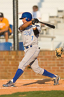 Yowill Espinal #7 of the Burlington Royals follows through on his swing versus the Johnson City Cardinals at Howard Johnson Stadium June 27, 2009 in Johnson City, Tennessee. (Photo by Brian Westerholt / Four Seam Images)