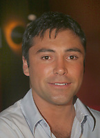 Miami Beach, FL 6-23-2003<br /> Boxer Oscar De La Hoya joins wife, singer <br /> Milly Corretjer at Touch Restaurant. The party was held to celebrate Millie gracing the cover of the July issue of Selecta Magazine.<br /> Photo by ©Adam Scull/PHOTOlink