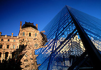 Musee du Louvre with glass pyramid Paris France.