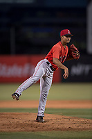 AZL Angels relief pitcher Emilker Guzman (73) follows through on his delivery during an Arizona League game against the AZL Diamondbacks at Tempe Diablo Stadium on June 27, 2018 in Tempe, Arizona. The AZL Angels defeated the AZL Diamondbacks 5-3. (Zachary Lucy/Four Seam Images)