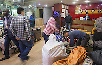 African and Chinese people pack boxes destined for Africa in an area of Guangzhou known to locals as 'Chocolate City', Guangzhou, Guangdong Province, China, 08 December 2014. The health authorities of Guangzhou are said to be stepping up their monitoring of the African community in light of the ongoing outbreak of the Ebola virus disease in West Africa.
