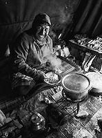 A camp cook prepares a meal in Ladakh.