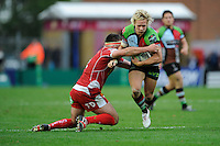Matt Hopper of Harlequins is tackled by Emyr Phillips of Scarlets during the Heineken Cup Round 1 match between Harlequins and Scarlets at the Twickenham Stoop on Saturday 12th October 2013 (Photo by Rob Munro)
