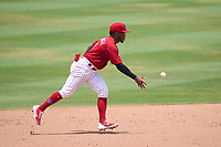 Clearwater Threshers shortstop Luis García (5) flips the ball to second base during a game against the Tampa Tarpons on June 13, 2021 at BayCare Ballpark in Clearwater, Florida.  (Mike Janes/Four Seam Images)