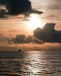 Boats begin to return home as weather approaches and sunset grows nearer.  Key West, Florida, USA.